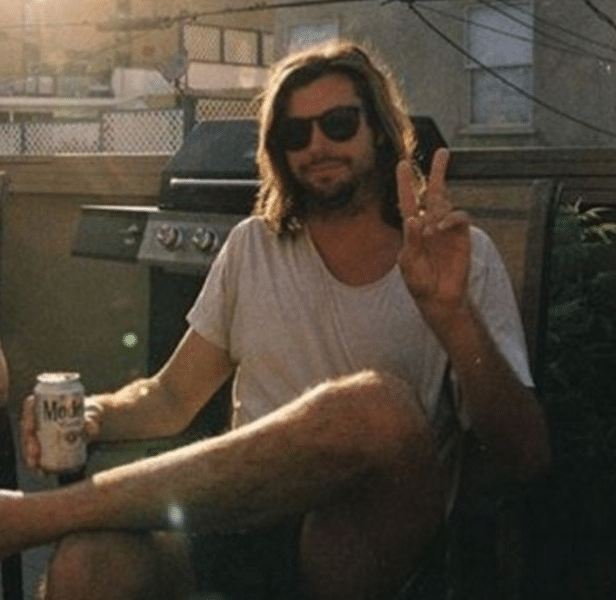 Surfing's poet laureate seen drinking a calorie rich beer and throwing a peace sign.